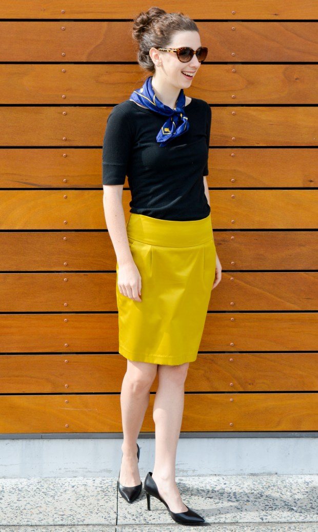 Black top + yellow skirt + navy and yellow scarf