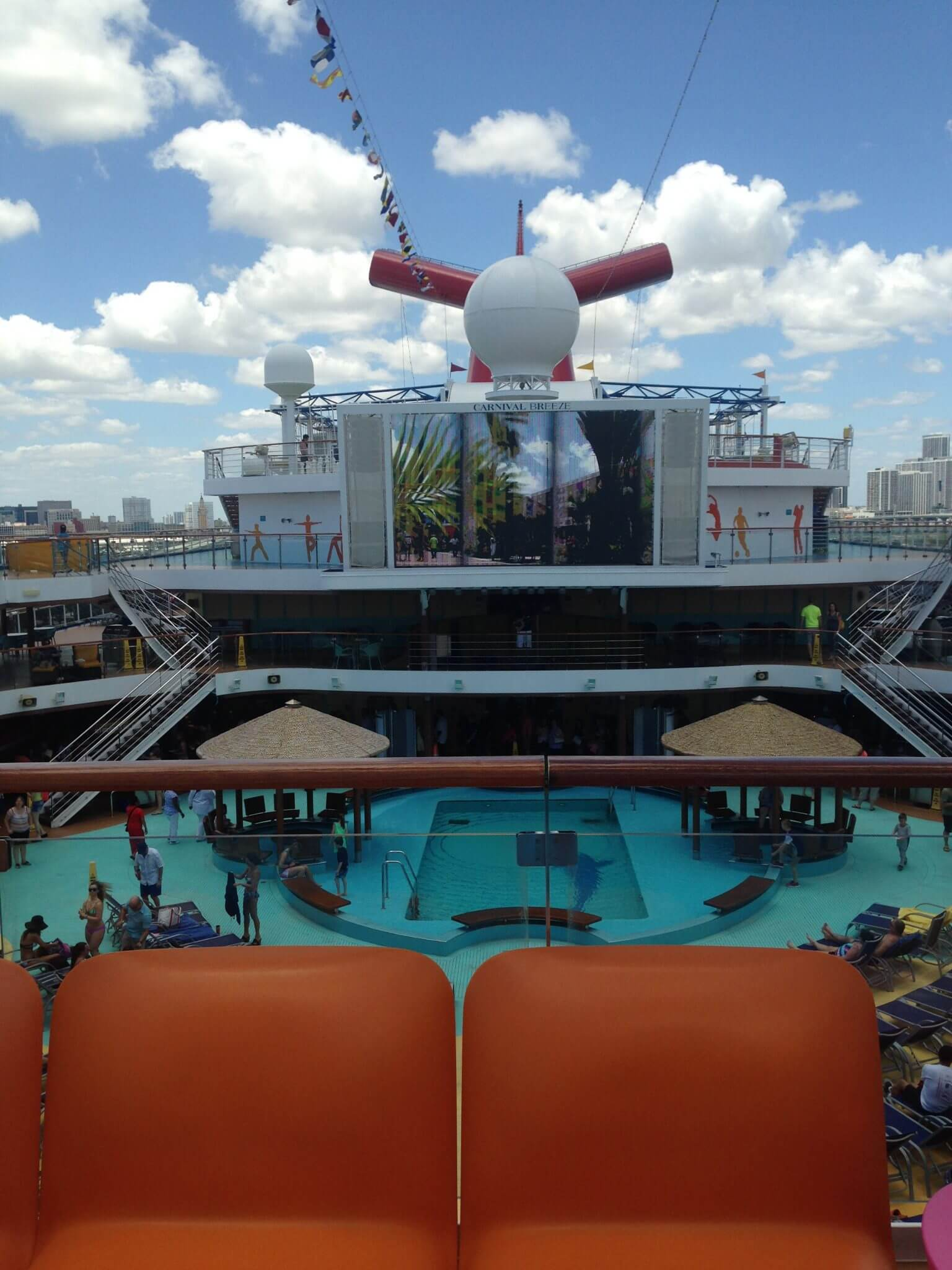 what everyone ought to know about the carnival breeze and fun ship main pool with giant movie theater screen