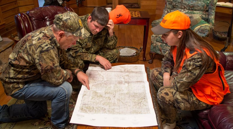 Hunters Reviewing a Map