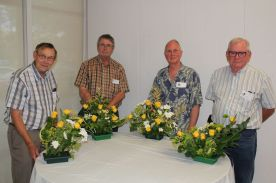 The Four Amigos with the floral designs created during a live demo with Edna Caldwell