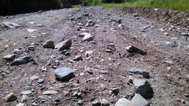 Chunky gravel on Wolf Lake Rd