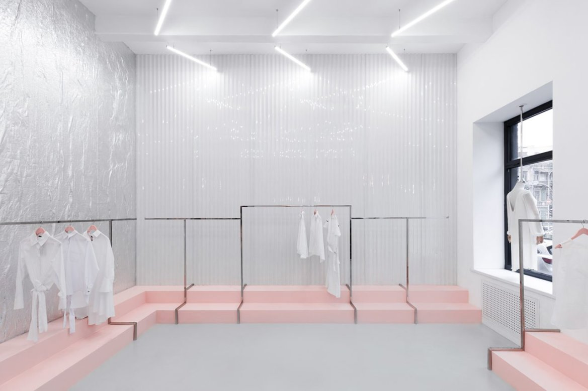 In Kiev, the architectural agency AKZ Architectura has designed a new shop with minimalist design and pink podiums.