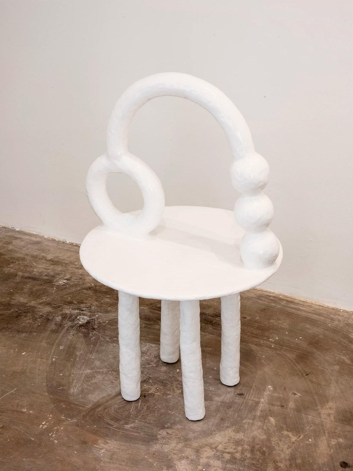 An organic white design chair designed by Brazilian artist Camilla D'Anunziata.