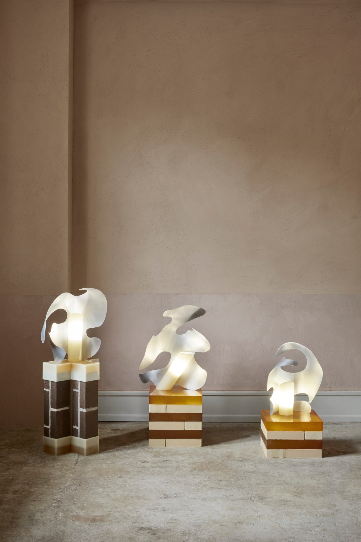 Metal sculptural lamps by Iza Elke