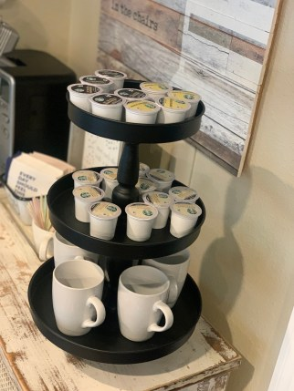 instant coffee pods, k cups, and white coffee mugs on stand