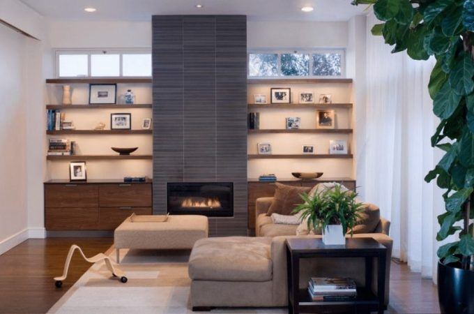 modern fireplace with bookshelves