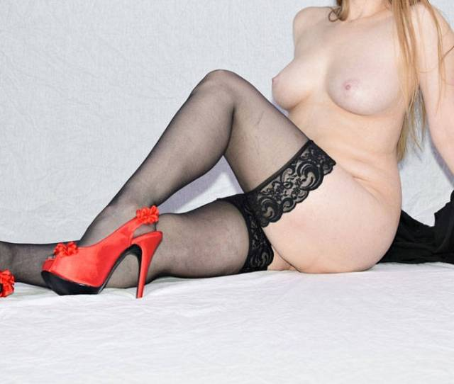 Nude Pose In Black Stockings And Red Heels