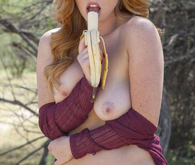Naughty Nude Redhead Eating Banana Outdoor Big Tits Exposed In Public Nipples