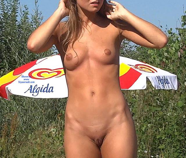 Naked Beauty In The Grass Blonde Hair Exposed In Public Firm Tits