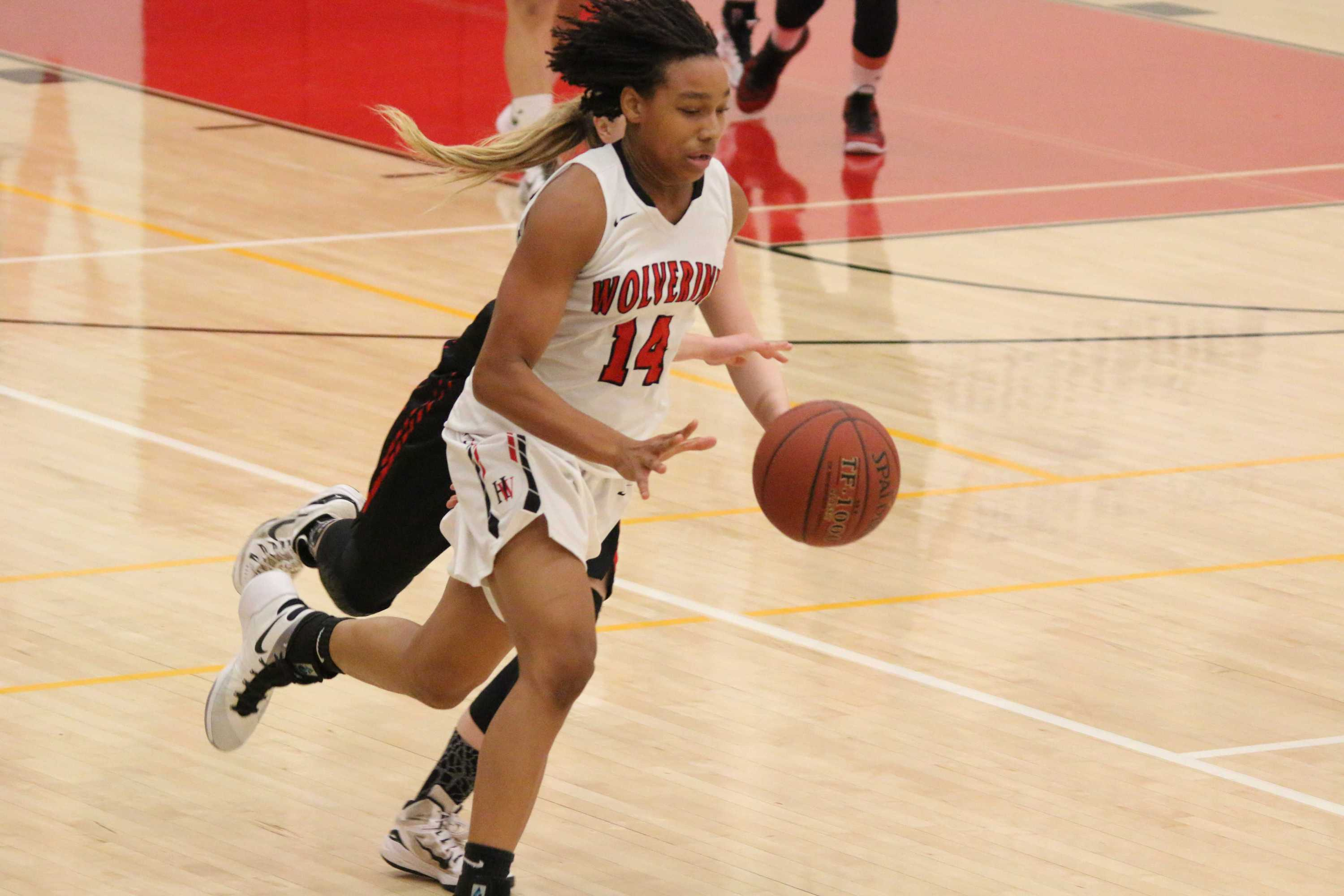 Jayla Ruffis-milner dribbles past an opponent during a game. Credit: Pavan Tauh/Big Red