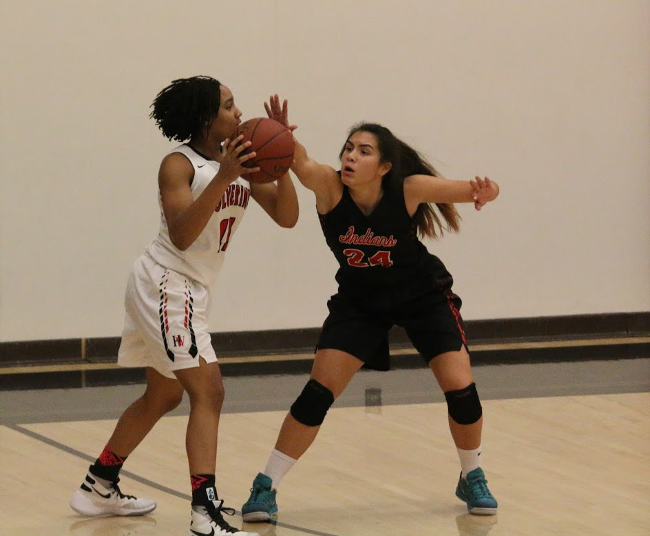Jayda Ruffus-Milner '18 attempts to pass the ball to a teammate while being guarded by an opponent. Credit: Pavan Tauh/Big Red