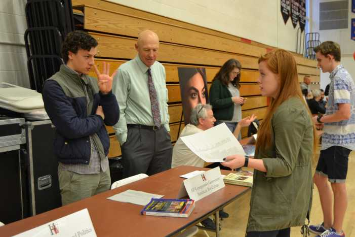 Students peruse course options at Academic Fair