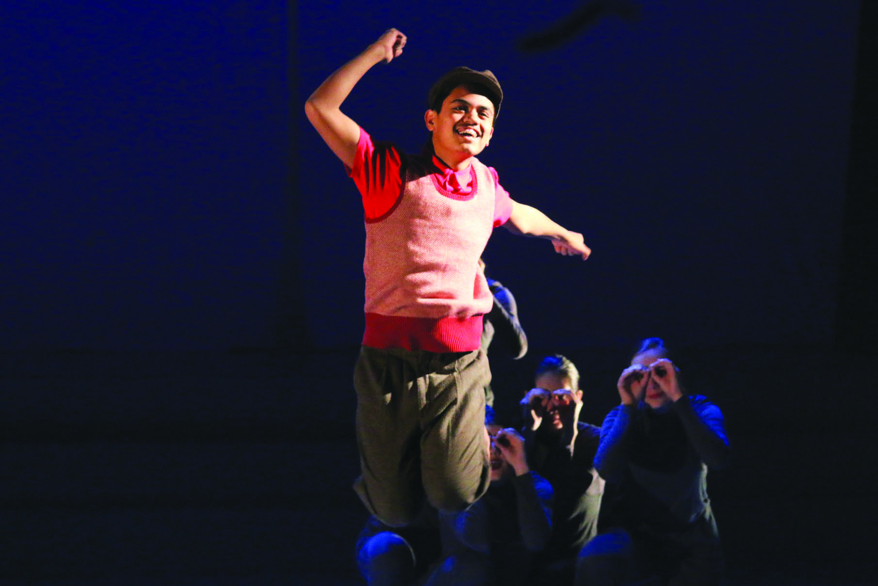 JUMP FOR JOY: Erick Gredonia '17, who plays Charlie, celebrates after being given the key to Willy Wonka's factory. Credit: Pavan Tauh/Chronicle