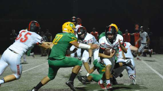 Football emerges victorious in first home game