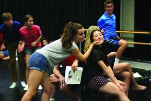 Natalie Musicant '17 praises Angel Hoyang '18 in rehearsal. Credit: Pavan Tauh/Chronicle, Kitty Luo/Chronicle.