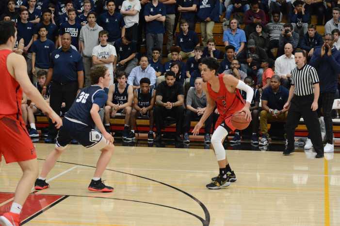 Boys' basketball edges rival