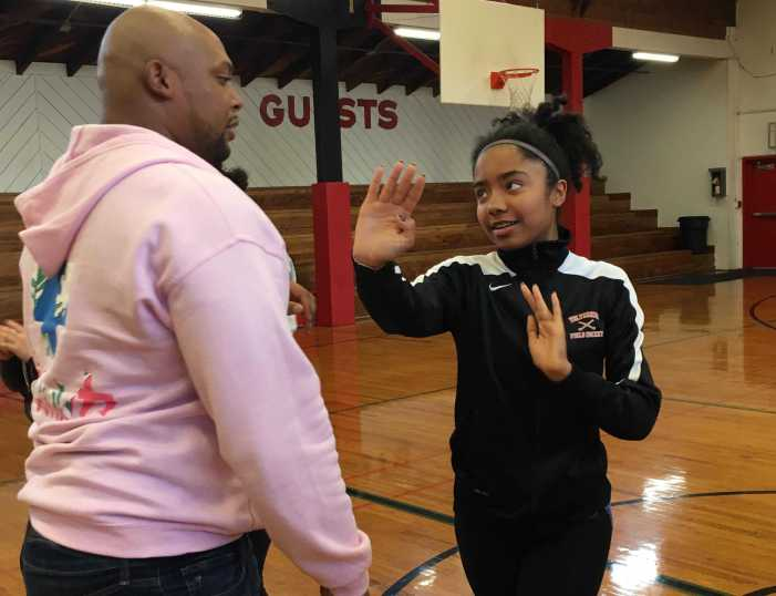 Junior and senior girls learn self defense strategies