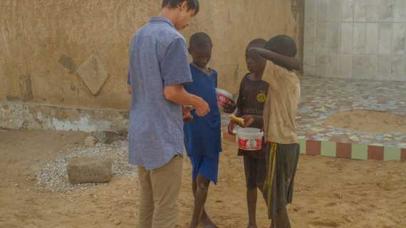 Kind 'sole': junior uses fellowship funds to send donated shoes to youth in Senegal