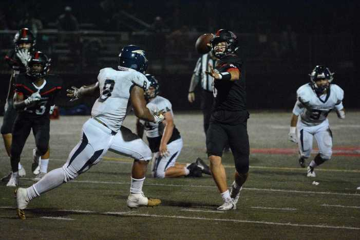 Football falls in season opener