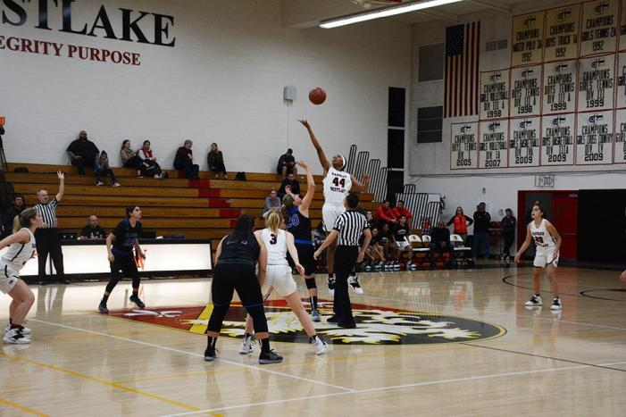 Girls' basketball wins season opener