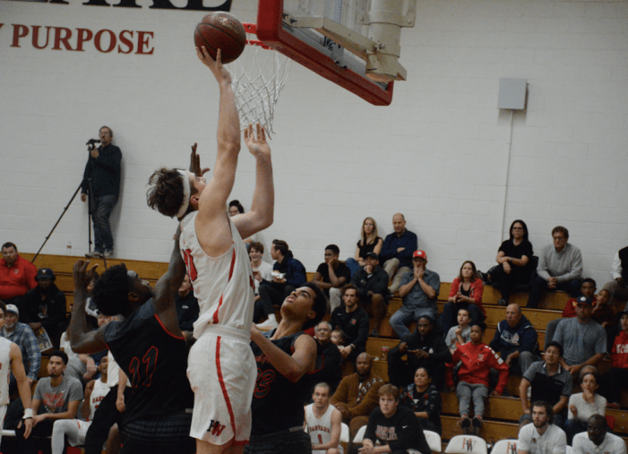 Boys' basketball secures its first home victory