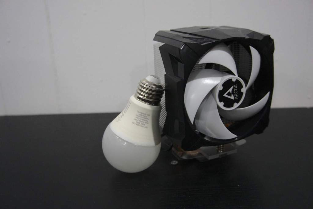 Arctic A13X with standard A19 lightbulb for scale