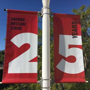 Banners cover poles around school