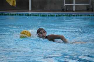 Pria Pant '18 races down the pool towards the goal. Credit: Uploaded with permission of Darlene Bible