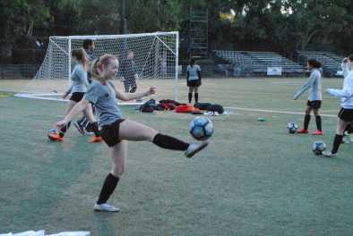 Katie Mumford '20 kicks a ball to warm up before the match. Credit: Casey Kim '20/SPECTRUM