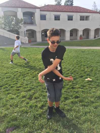 Novikov displays a number of dance moves he has learned over the years in front of the Horns Commons.