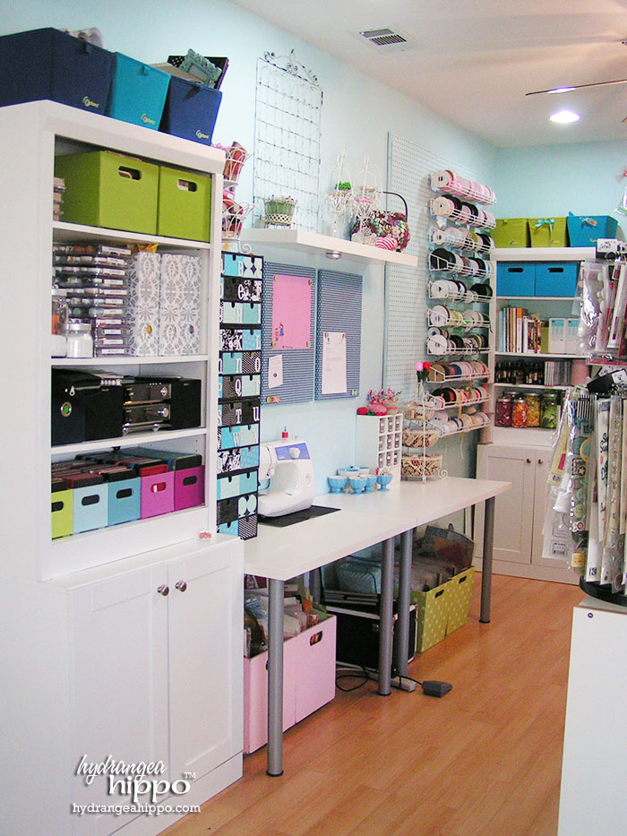 Die cut center, sewing area, storage, and ribbon wall in Jennifer Priest's Scrapbook Room.