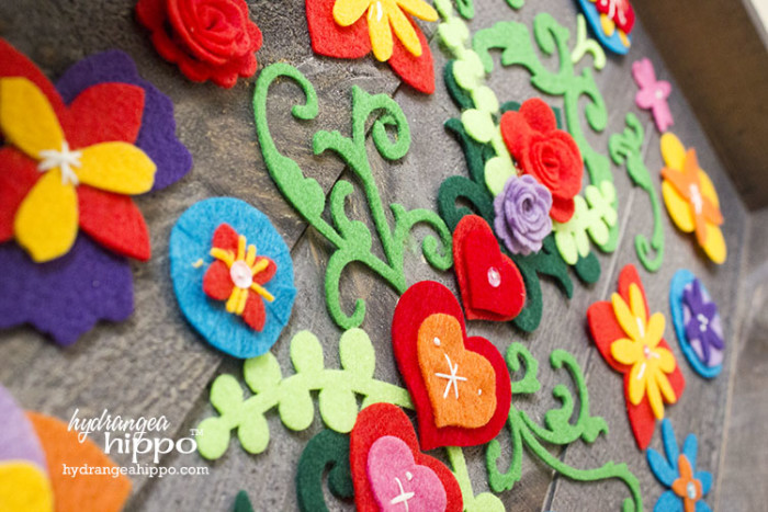 Felt Flower Collage on Wood JPriest - Create this garden wall art for your garden decor with flowers made from Kunin felt and a Walnut Hollow Rustic Panel. Flowers made with SIizzix dies.