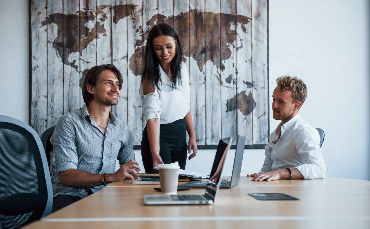 Young business people in formal clothes working in the office