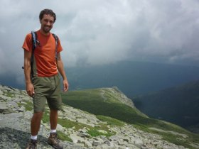 Tyler taking a break from field work and hiking in the Whites.