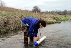 Tyler check suspended sediment samplers on Stroubles Creek.