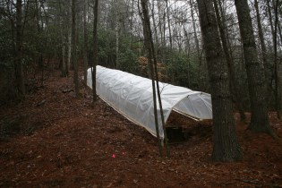 Completed hoop-house, which is designed to keep out precipitation while letting in solar radiation.