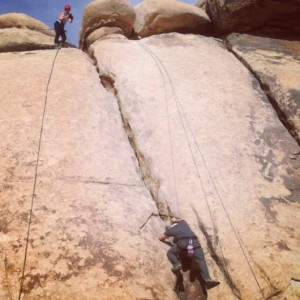 A calculated risk: taking my first rock-climbing experience before everybody else in order to film Corey coming up. Photo by Katie Gutierrez.