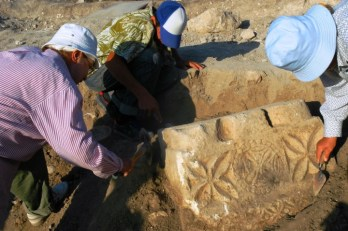 The archeological team examining an early Christian architectural detail.