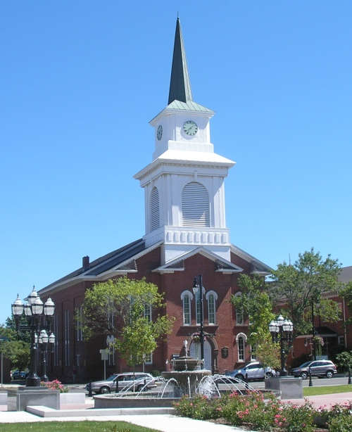 The 1st Congregational Church of Westfield, located on Broad Street across from Westfield Green, is an impressive Italianate edifice. It is the church's fourth meeting house. The first was built around 1673 and the second around 1720. The latter building burned in 1803 and was replaced in 1805 by a new meeting house. The present church building was erected in 1860, with L. F. Thayer as architect and George Green as builder. The original steeple was damaged in a windstorm on 27 Feb 1886. It was replaced by an extremely elaborate second steeple, which was in turn replaced by the current steeple, erected in 1962.