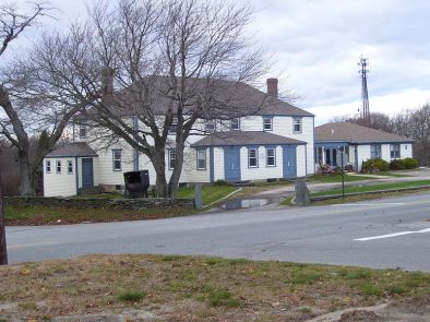 Portsmouth Friends Meetinghouse, Parsonage and Cemetery: The current meetinghouse was built around 1699-1700. During the American Revolution, British troops occupied the building. The meeting house was added to the National Register of Historic Places in 1973 (photo taken 2008).