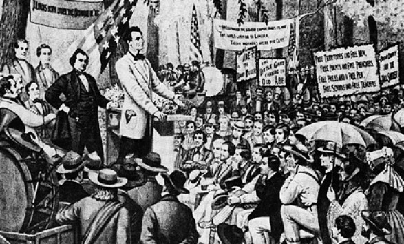Abraham Lincoln speaks as Stephen Douglas looks on in during one of their seven debates in the 1858 campaign for Illinois senatorship.