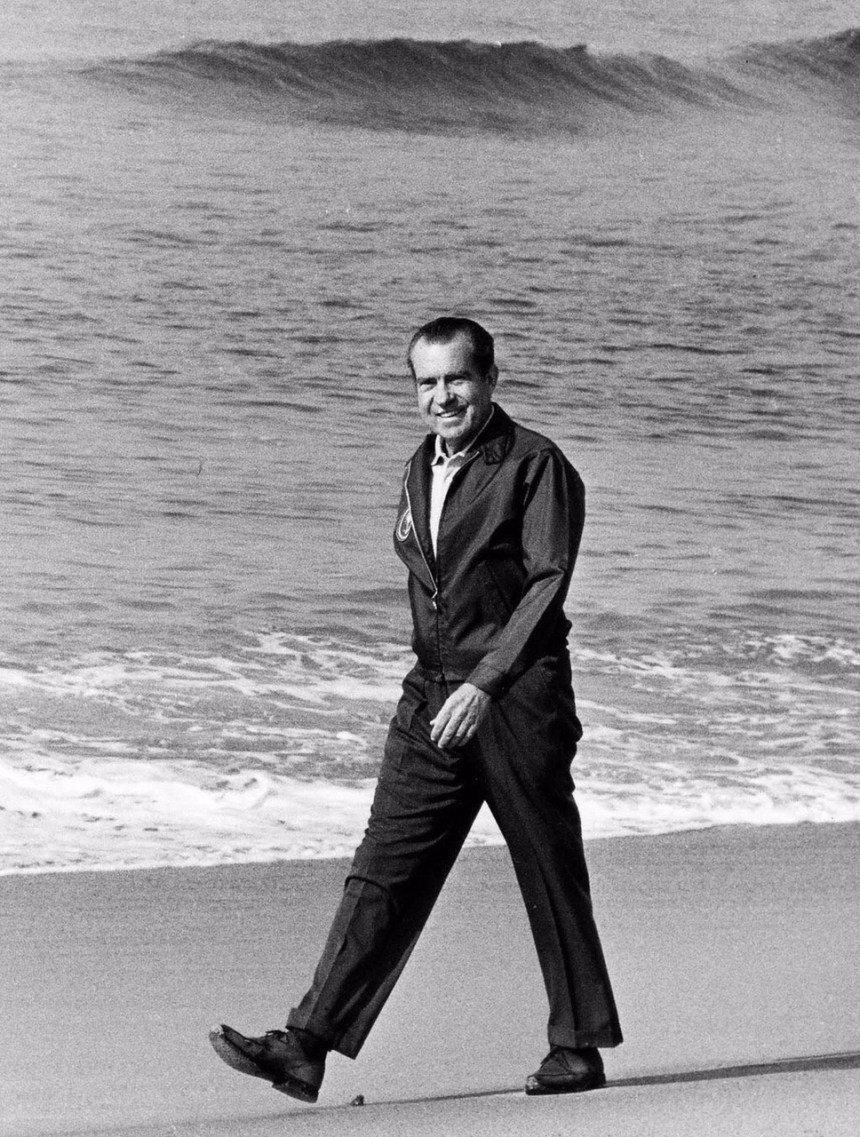 Nixon walking on the beach in San Clemente, California