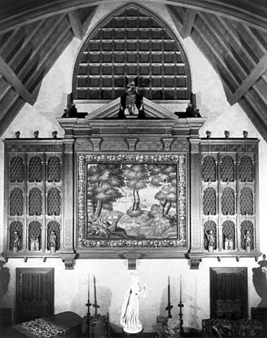 The carved oak organ screen