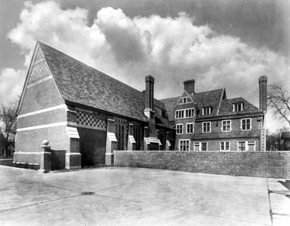 Looking north from forecourt west of garage showing rear of great hall and servants quarters