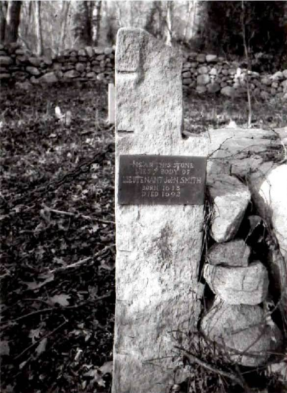"""Grave marker of John Smith (1618-1692), the husband of Arthur's daughter, Deborah. John has no actual gravestone. He is purportedly interred at what is now known as the private Smith Family Burying Ground located behind a private residence in South Dartmouth, Massachusetts. In the 1600s as Quakers frowned on erecting gravestones as symbols of personal vanity, and no actual gravestone marks the spot of his burial. An engraved metal plaque mounted on a stone post at the entrance to this old private family cemetery reads: """"Near This Stone Lies Ye Body of Lieutenant John Smith Born 1618 Died 1692"""". The principle errors regarding """"Lieut. John Smith, Jr."""" are that as a Quaker he never was a """"Lieut."""", and he was not knowingly the son of a John Smith. He was called John Smith, Jr. at Plymouth only because he was the younger of two John Smiths that resided at Plymouth for many years, and both Mr. Crapo Smith and Melatiah Dwight badly confused them. He was called John junior only in the records of the Town of Plymouth, but when he resettled at Dartmouth, Massachsetts, he was known simply as John Smith."""