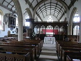 Interior view east towards chancel, showing Wyndham Chapel in north aisle to left