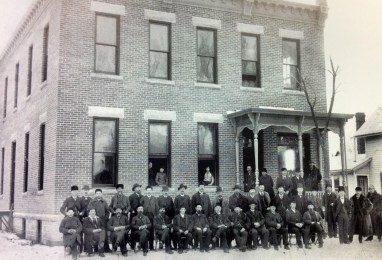 This 1891 photograph shows J.R. Watkins (third from right, wearing a top hat), posing for a picture with Watkins salesmen in Winona, Minnesota.