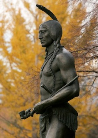 """This bronze sculpture of Chief Massasoit, or """"Yellow Feather,"""" stands on the campus of Brigham Young University in Provo, Utah. The original sculpture was created by Cyrus Dallin and placed in Plymouth, Massachusetts around 1921(where it still stands). BYU's Massasoit statue was cast from Dallin's plaster original, which was donated to the university. Another bronze of the statue appears on Utah's state capitol grounds."""