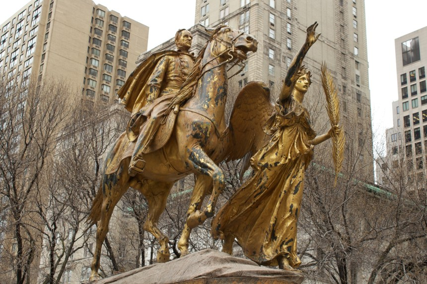 """The Sherman statue in New York City, at the park southeast entrance to Central Park at Fifth Avenue and West 59 Street, was the last major work by noted sculptor Augustus Saint-Gaudens. The monument, dedicated in 1903, depicts the general atop his horse being led by Nike, the goddess of victory. Nike holds a palm branch, representing peace, aloft in her left hand. A dedication on the south face of the monument's base reads, """"To General William Tecumseh Sherman, born Feb. 8, 1820, died Feb. 14, 1891. Erected by citizens of New York under the auspices of the Chamber of Commerce of the State of New York."""""""