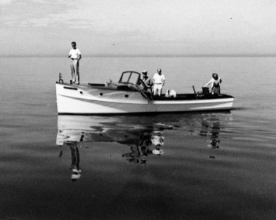 """Wally Walholm, standing on the bow of the """"Wenonah"""" (Whitney Beach, Florida - undated)"""
